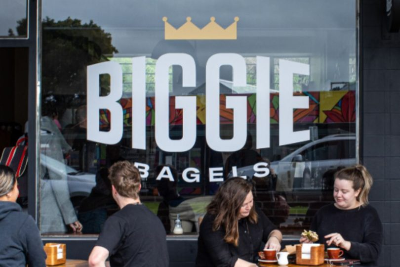 Customers sitting outside Biggie Bagels