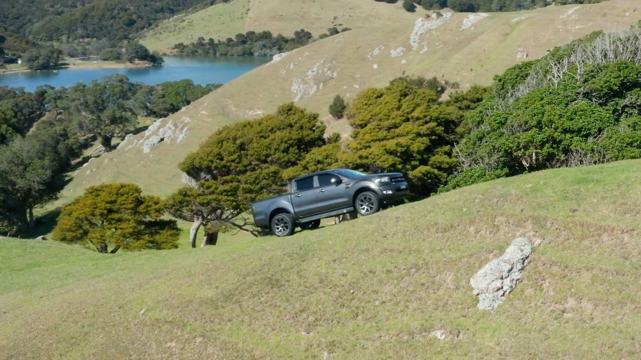 Ford Ranger driving up steep Northland terrain overlooking the coast