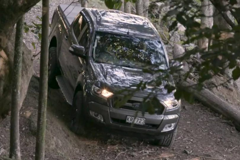 Ford Ranger going down steep hill in a Northland forest
