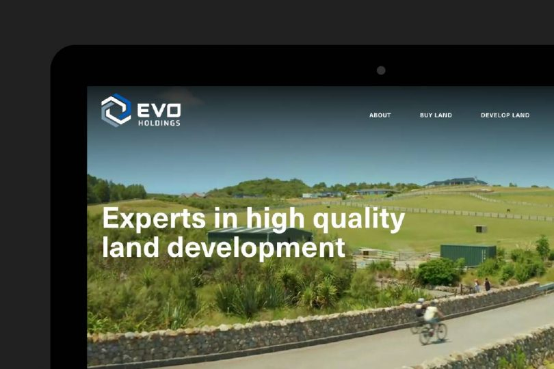 Screenshot of the Evo Holdings website on a laptop