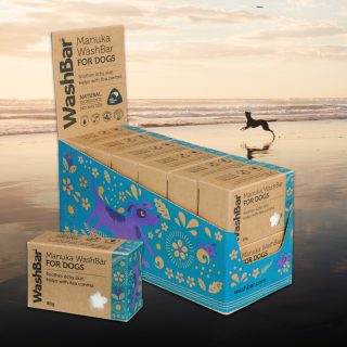 Box of Washbar soap with dog playing on the beach in the background